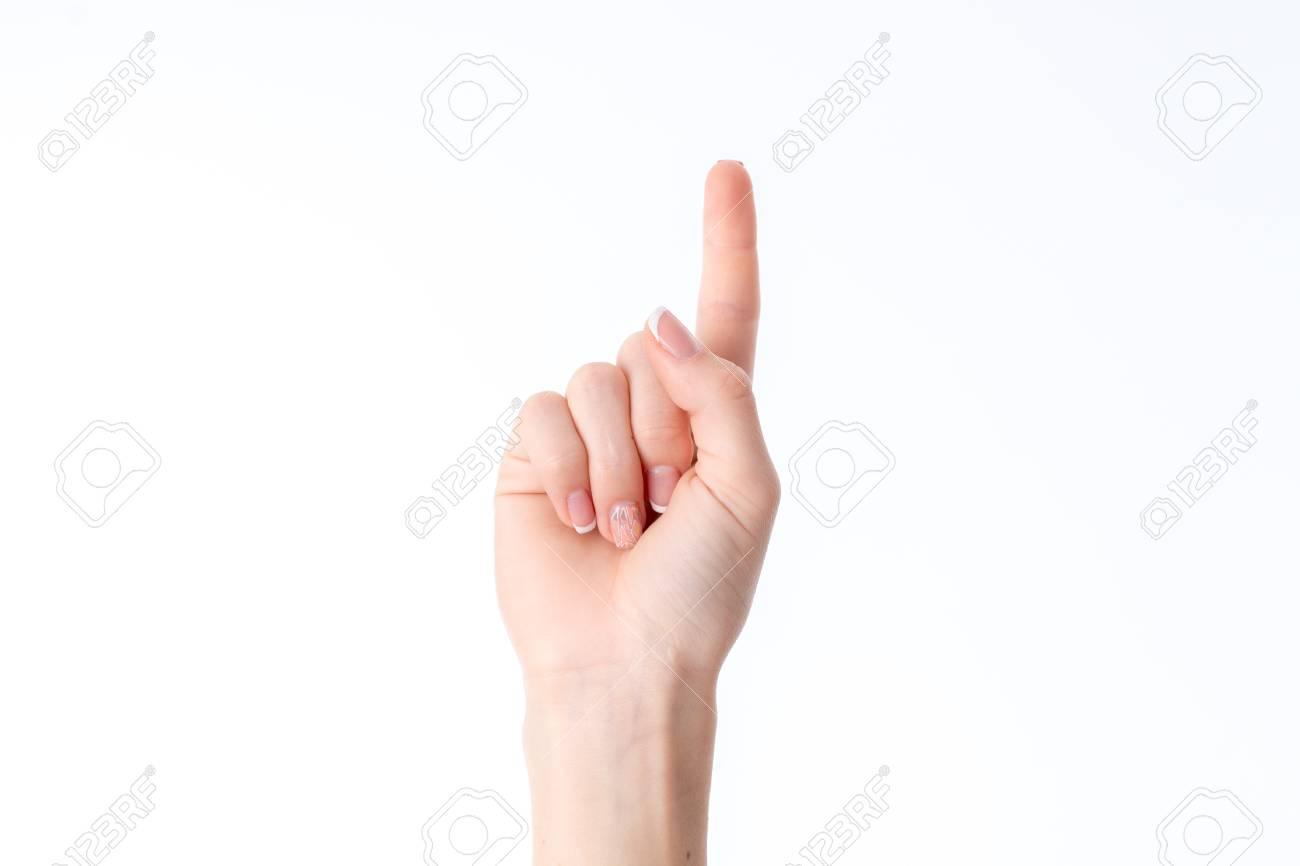 Weibliche Hand Die Geste Mit Erweckte Einen Finger Isoliert Auf ...